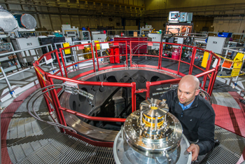 Sandia National Laboratories physicist Thomas Awe examines coils that reduce plasma instabilities in the quest for controlled nuclear fusion at Sandia's Z machine. (Photo by Randy Montoya)