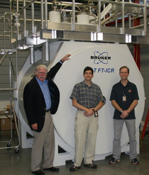 Pictured with the Bruker 21 Tesla FT-ICR magnet at the NHMFL lab are (from left to right): Professor Alan Marshall, the Robert O. Lawton Professor of Chemistry and Biochemistry at Florida State University and Director of the High Field FT-ICR program at the NHMFL; John Quinn, 21 T FT-ICR engineering lead at NHMFL; Dr. Chris Hendrickson, 21 T FT-ICR project advisor at the NHMFL.